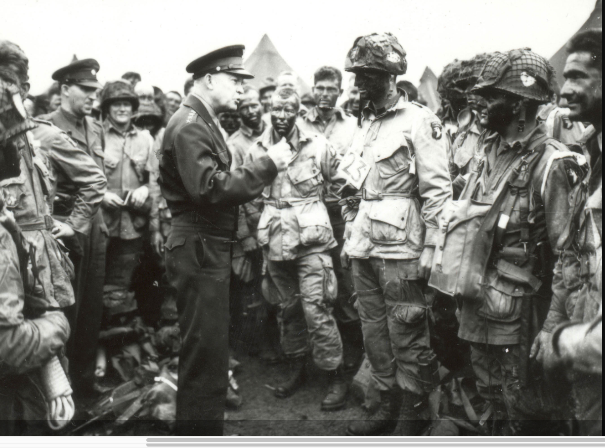 Gen. Dwight D. Eisenhower visits with paratroopers June 5, 1944, on the eve of D-Day.